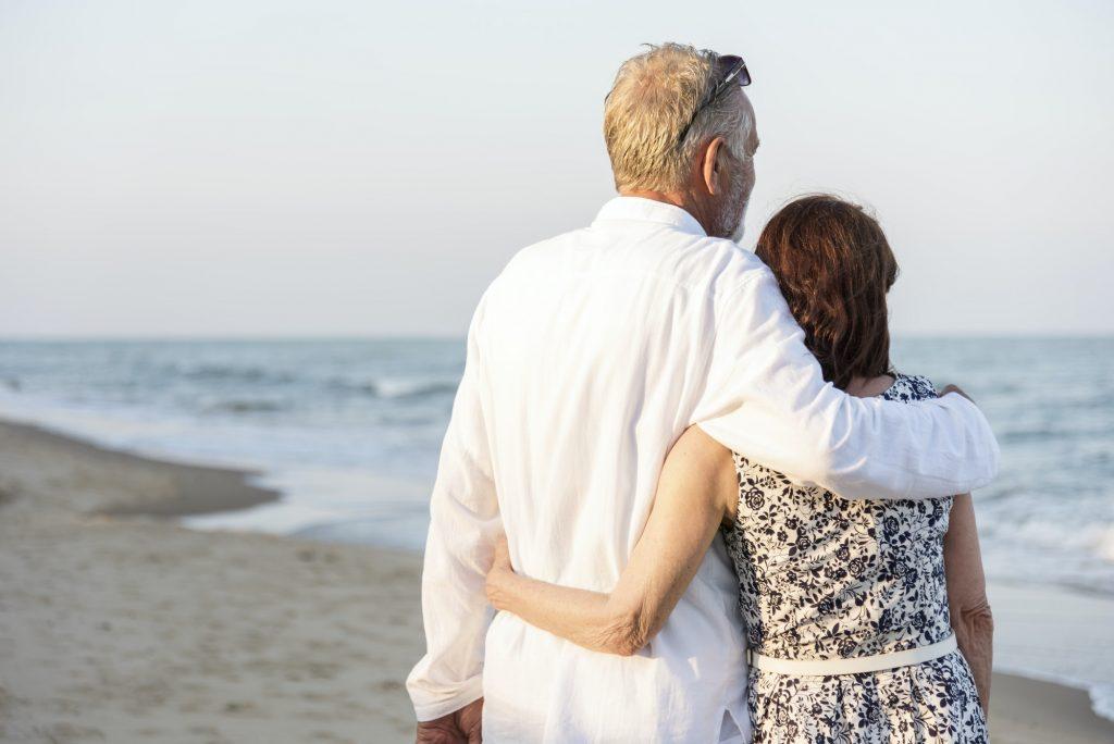 A senior couple on the beach